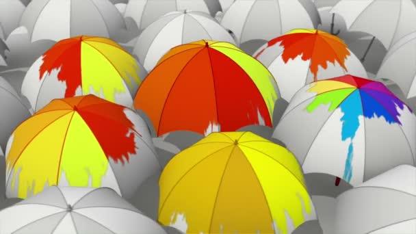 Gocce colorate che cadono sugli ombrelli