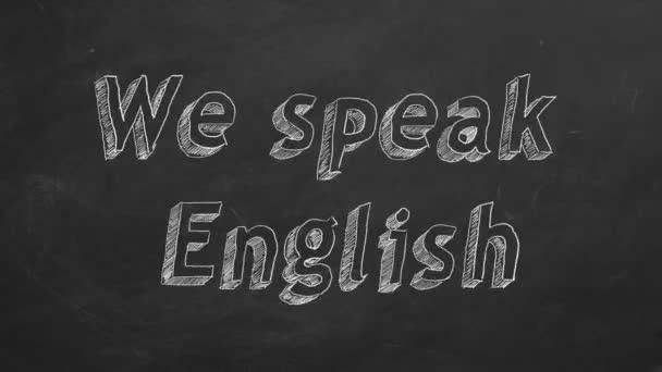 Hand drawing We speak English on black chalkboard. Stop motion animation.