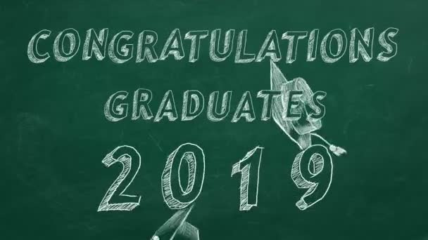 Hand drawing text Congratulations graduates.  2019. and graduation caps  on green chalkboard.