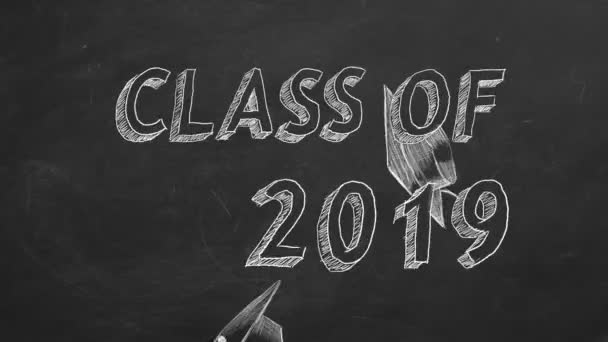 Hand drawing Class of 2019 and graduation caps on blackboard