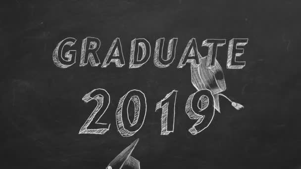 Hand drawing Graduate 2019 and graduation caps on blackboard