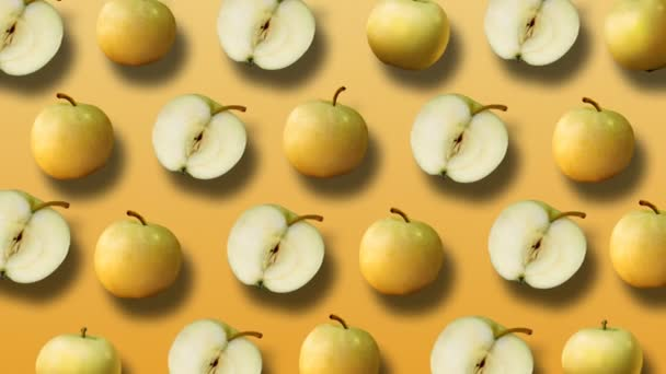 Colorful fruit pattern of fresh yellow apples on yellow background. 4k video.