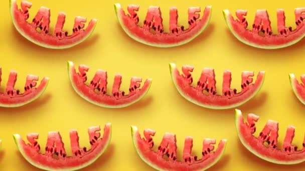 Fresh slices of watermelon on yellow background. Word SALE  carved in every piece.