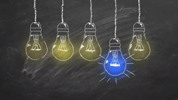 Egy sor villanykörte kréta rajzol a táblára. Egyedülálló gondolkodásmód