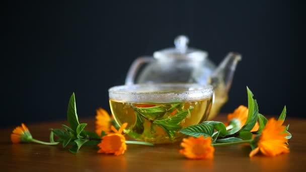 fresh hot tea with calendula