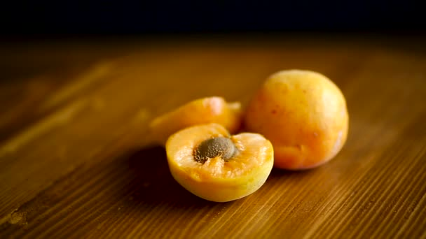Ripe apricots fruit on wooden table