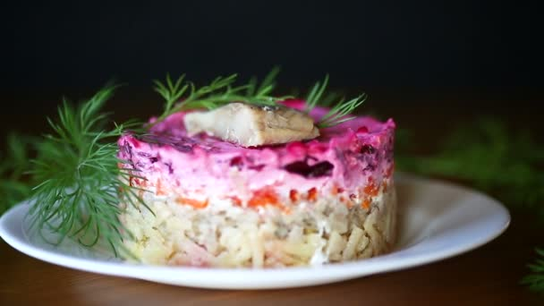 layered salad of boiled vegetables with beets and herring