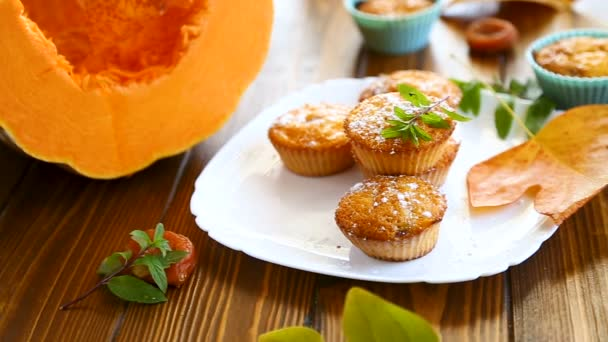 baked sweet pumpkin muffins with dried apricots inside,