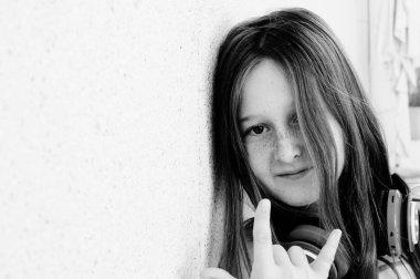 Portrait of cute teenage girl listening music on headphones