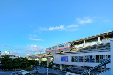 Naha, Okinawa, Japan - August 20 2018: Okinawa Monorail 1000 series trains passing at Oroku Station, Okinawa, Japan
