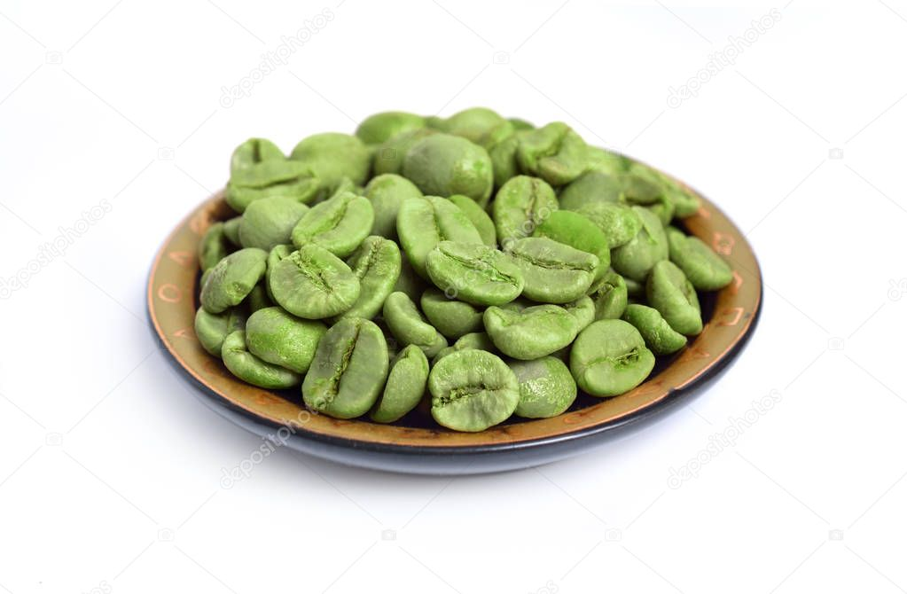 Green coffee beans isolated on white background.