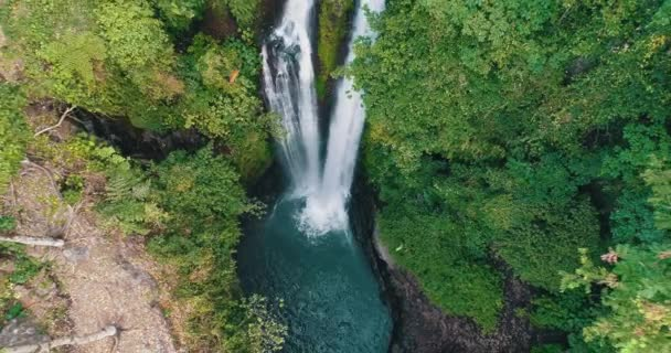 Aerial drone view of beautiful Aling Aling waterfall in nothern Bali, Indonesia
