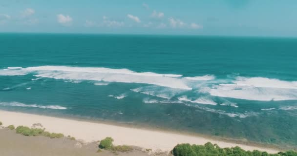 Aerial drone view of beautiful Nyang Nyang beach in Bali during sunny summer day, Indonesia