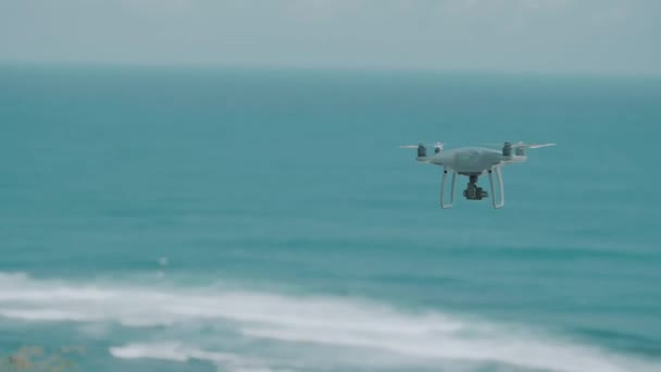 Footage of drone flying above beautiful ocean on sunny summer day with blue sky