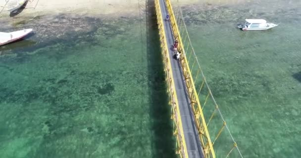 Aerial drone view of Yellow Bridge connecting Nusa Lembongan with Ceningan in Bali, Indonesia