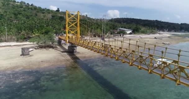 Aerial drone view of Yellow Bridge connecting Nusa Lembongan with Ceningan in Bali, Indonesia