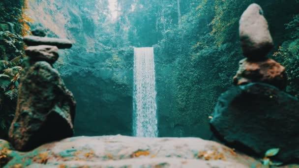 Stone zen towers with beautiful waterfall background