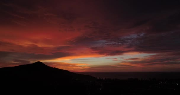 Aerial drone view of amazing dramatic sky during sunset. Island's city view under the clouds at sundown