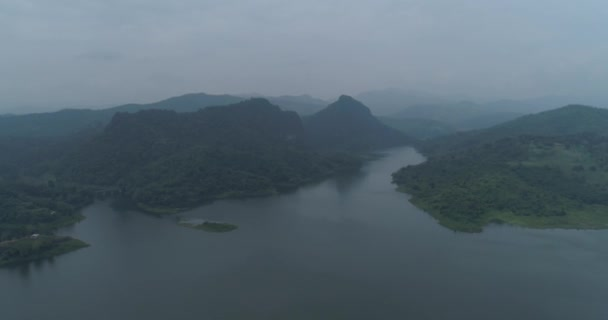 Aerial drone view of Chiang Rai beautiful mountains and river with dam landscape during foggy morning, Thailand