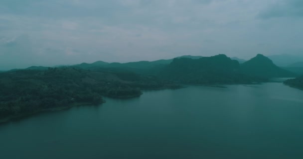 Aerial drone view of Chiang Rai beautiful mountains and river landscape during foggy morning, Thailand