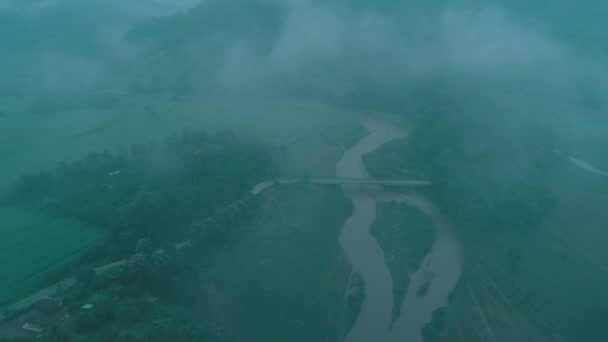 Aerial drone view of Chiang Rai area with beautiful mountains and river during foggy morning, Thailand