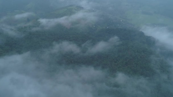 Aerial drone view of Chiang Rai area with beautiful mountains landscape during foggy morning, Thailand