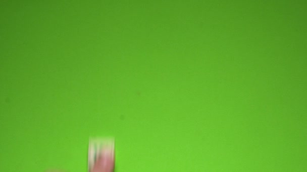 Womans hand creating word of when with the letters on the green screen background