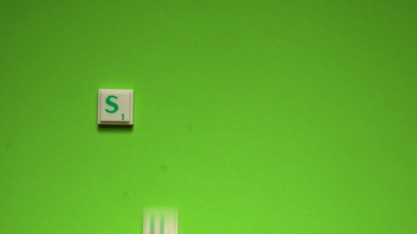 Womans hand creating word of Summer with the letters on the green screen background