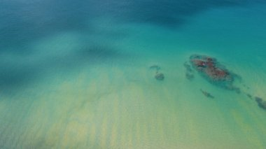 Aerial drone top view of transparent shallow water and sea ocean surface