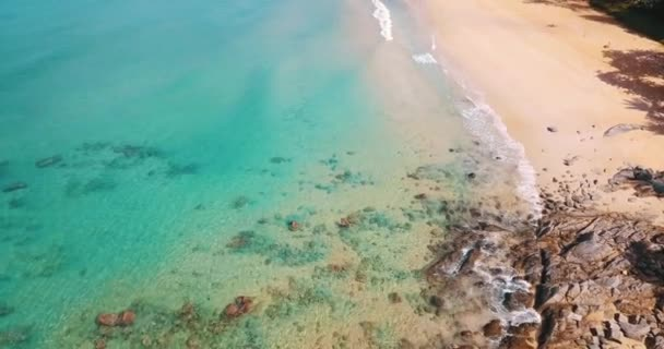 Aerial drone view of beautiful sandy beach on tropical island with lagoon sea water. Summer and travel vacation concept