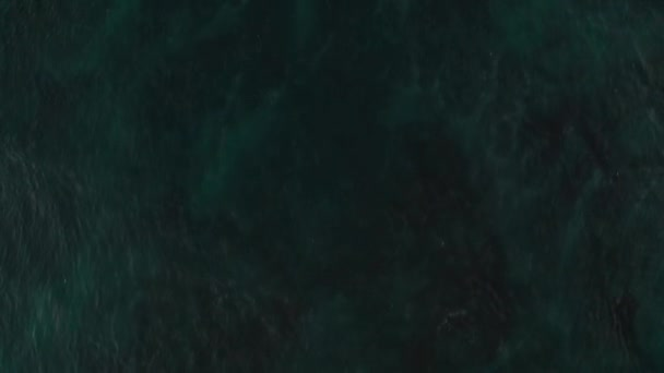 Aerial drone top view of the sea ocean water surface with coral reef