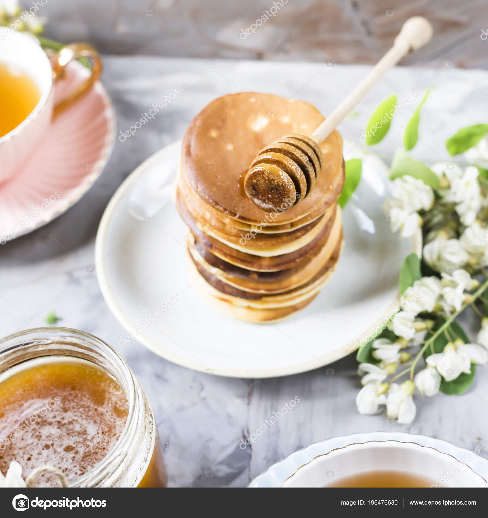 Pile Fritters Next Cup Tea Jar Honey Gray Background Flowers Stock