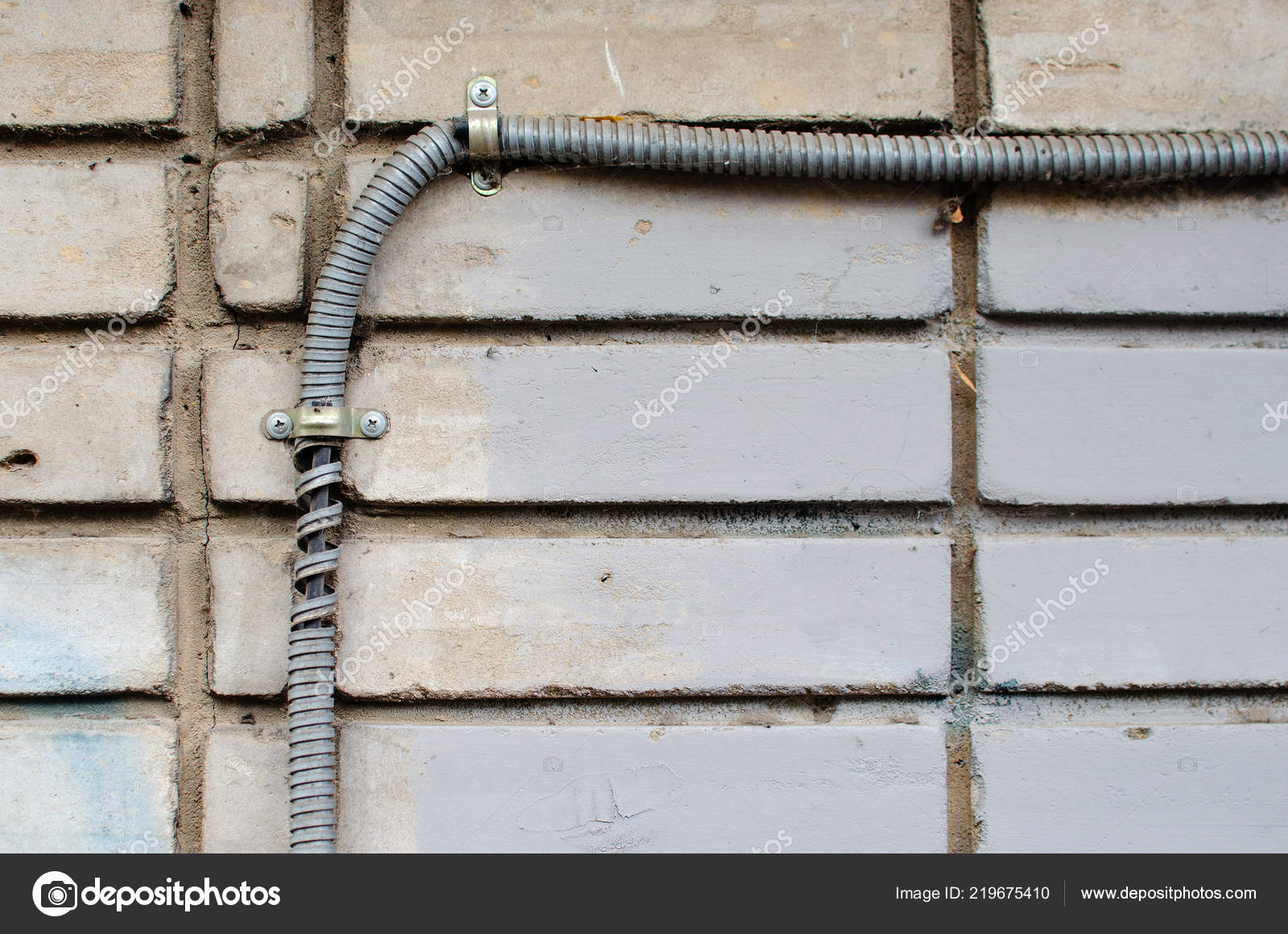 Surprising Corrugated Wires Stretched Along A White Brick Wall In The Street Wiring 101 Akebretraxxcnl