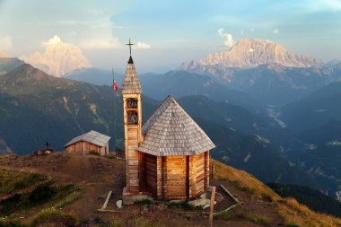 Evening view from mount Col DI Lana with chapel to Monte Pelmo and mount Civetta, one of the best view in Italian Alps Dolomites mountains