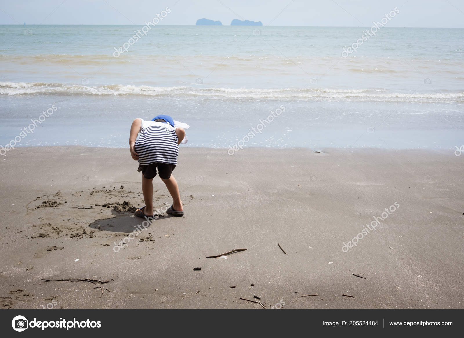 67da3f42f82 Behind of boy searching for hermit crab and garbage collector hobby and  leisure concept– stock image