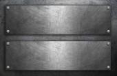 Nerezová deska s nýty na kovové pozadí