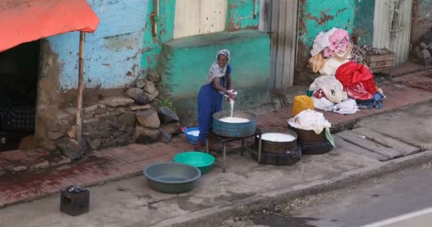 Ethiopian woman wash laundry on Gondar, Ethiopia