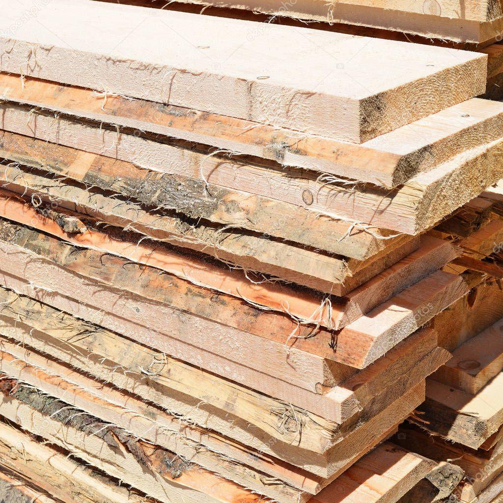 An edging board in stacks in an industrial landscape