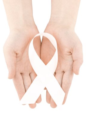 healthcare and medicine concept - womans hands holding white ribbon.