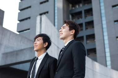 Two confident businessmen looking forward