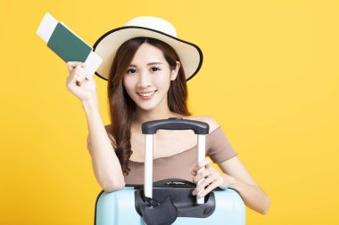 Happy tourist woman in summer hat holding  passport and suitcase stock vector