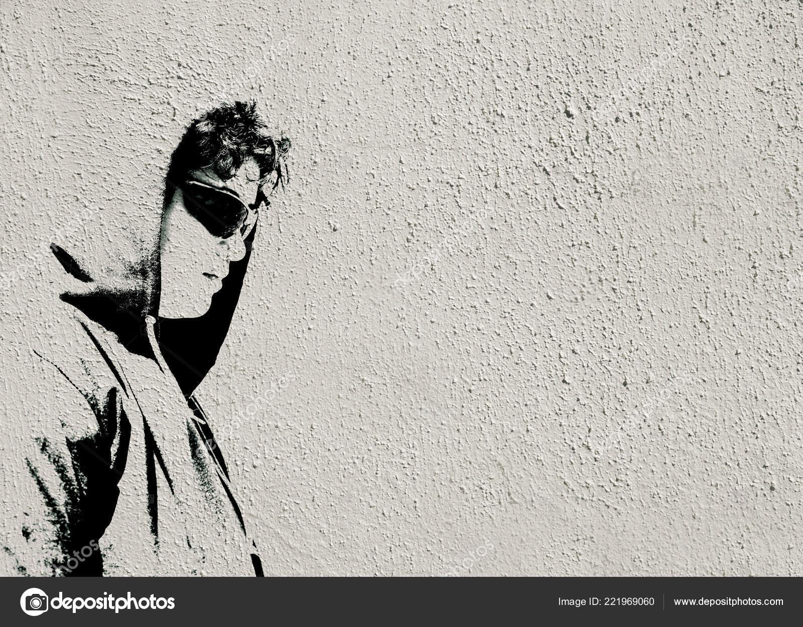 Sad troubled teenager school boy hood dark sunglasses posing