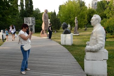 MOSCOW, RUSSIA - JUNE 29, 2018:Unidentified woman photographs the sculpture