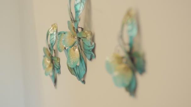 Decorative butterflies hang on a wall