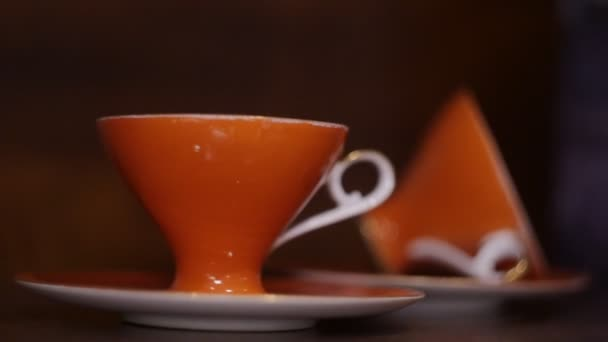 two orange cups of tea or coffee
