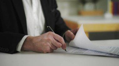 Businessman signs documents