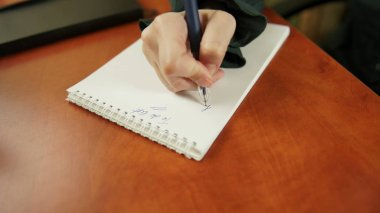 woman writing to do list