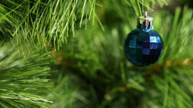 Panorama blue fur-tree toy on a green Christmas tree.