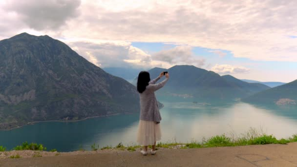 Boho Woman Traveling and Taking Panorama Photo on her Smartphone