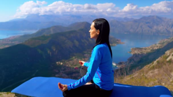 Lady Sitting in Lotus Pose and Meditating. Mountains on Background